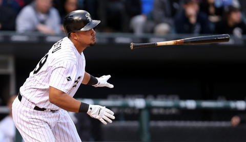 Jose Abreu triples in a run in the first inning of a game against the Red Sox at U.S. Cellular Field on May 3, 2016.