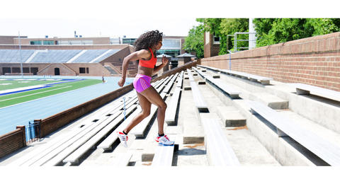 Francena McCorory, a former Hampton University NCAA champion and Olympic gold medalist, easily runs up the benches at Armstrong Stadium.