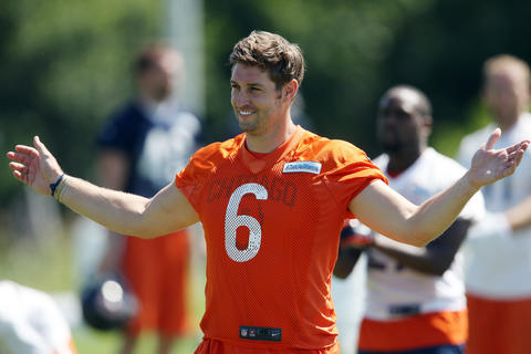 Jay Cutler stretches with his teammates during the second day of Bears' mandatory minicamp on June 15, 2016 at Halas Hall.