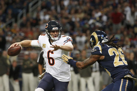 Jay Cutler looks to throw as the Rams' Mark Barron applies the pressure in the second quarter.