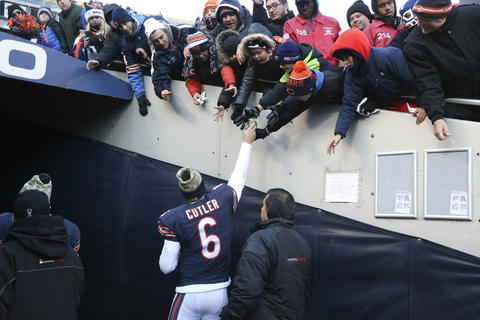 Chicago Bears quarterback Jay Cutler walks off the field after his team's loss to the Denver Broncos, at Soldier, Field, in Chicago, on Sunday, Nov. 22, 2015.