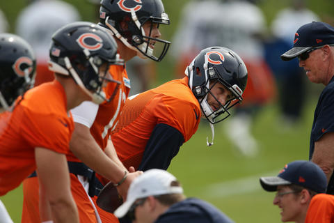 Bears quarterbacks led by Jay Cutler participate in a drill during an OTA practice on May 25, 2016 at Halas Hall.