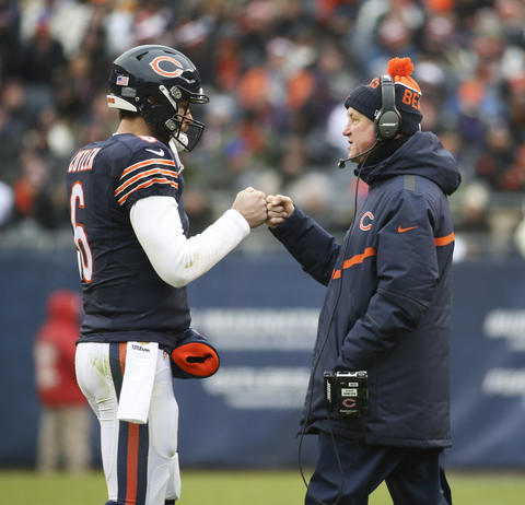 Bears quarterback Jay Cutler and coach John Fox after a first down against the Lions.