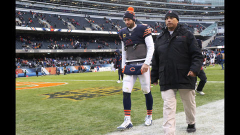 Bears quarterback Jay Cutler walks off the field after a 24-20 loss to the Lions at Soldier Field.
