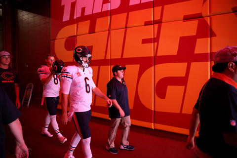 Chicago Bears quarterbacks Jay Cutler and Jimmy Clausen head out for warmups before a game against the Kansas City Chiefs at Arrowhead Stadium in Kansas City, Missouri on Sunday, October 11, 2015.