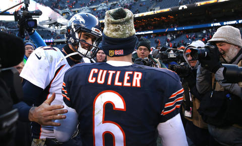 Denver Broncos quarterback Brock Osweiler and Chicago Bears quarterback Jay Cutler greet one another after a Bears loss at Soldier Field in Chicago on Sunday, Nov. 22, 2015.