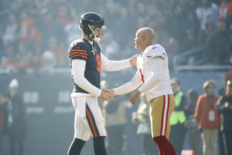 Chicago Bears quarterback Jay Cutler shakes hands with San Francisco 49ers kicker Phil Dawson after the coin toss before the start of the game at Solider Field Sunday, Dec. 6 2015, in Chicago.
