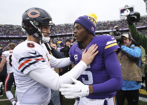 Chicago Bears quarterback Jay Cutler, congratulates Minnesota Vikings quarterback Teddy Bridgewater, at the end of their team's game, at TCF Bank Stadium, in Minneapolis, Minnesota, on Sunday, Dec. 20, 2015.
