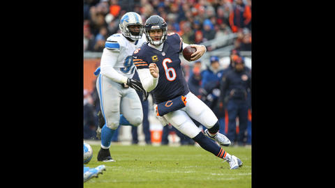 Bears quarterback Jay Cutler scrambles in the first quarter against the Lions at Soldier Field.