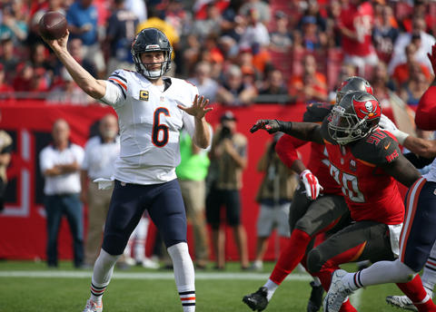 Bears quarterback Jay Cutler passes under pressure from Tampa Bay Buccaneers defensive tackle Henry Melton on Sunday, Dec. 27, 2015, at Raymond James Stadium in Tampa.