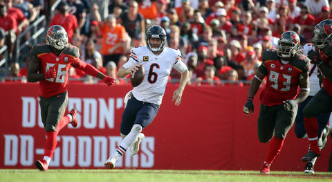 Chicago Bears quarterback Jay Cutler scrambles ahead of Tampa Bay Buccaneers defensive end Jacquies Smith, left, in the fourth quarter Sunday, Dec. 27, 2015, at Raymond James Stadium in Tampa.
