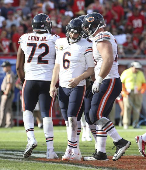 Bears quarterback Jay Cutler, with offensive tackle Kyle Long, right, after he ran for some yardage against the Tampa Bay Buccaneers on Sunday, Dec. 27, 2015.