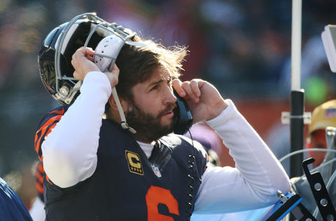 Jay Cutler talks to coaches on the phone after throwing an interception-for-touchdown by the 49ers in the first quarter at Soldier Field.