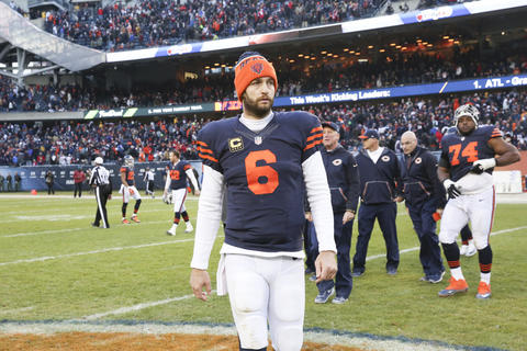 Jay Cutler walks off the field after the OT loss to the 49ers.