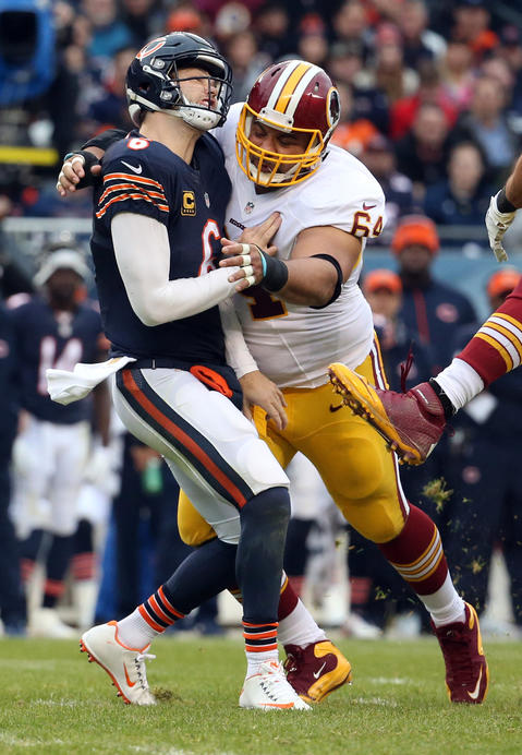 Jay Cutler is hit by the Redskins' Kedric Golston in the second quarter.