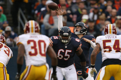 Jay Cutler nearly fumbles the snap during the first half but gets off the pass for a first down against the Redskins.