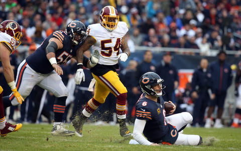Jay Cutler slides in front of Redskins linebacker Mason Foster in the second quarter.