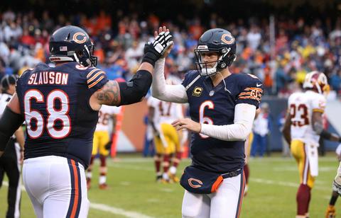 Matt Slauson and quarterback Jay Cutler celebrate after Cutler threw a touchdown in the third quarter against the Redskins.