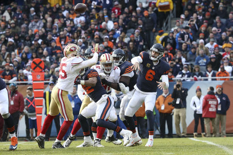 Jay Cutler throws a pass during the first half against the 49ers at Soldier Field.