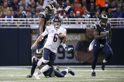 Jay Cutler runs the ball during the second half against the Rams at Edward Jones Dome.
