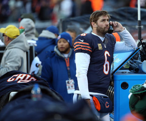 Jay Cutler takes a call from the coaching booth after the Bears failed to convert a two-point conversion against the Broncos to tie the game late in the fourth quarter.