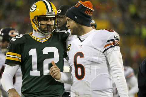 Aaron Rodgers and Jay Cutler chatduring halftime of their game at Lambeau Field.