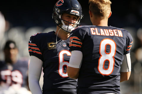 Jay Cutler talks with quarterback Jimmy Clausen before the game against the Vikings.
