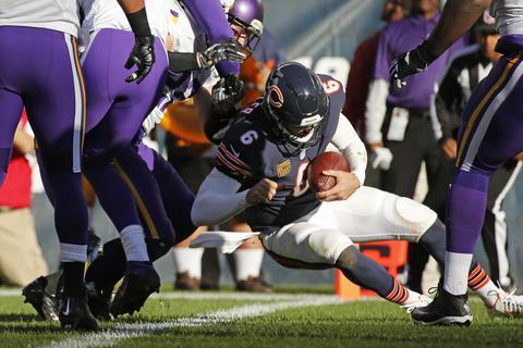 Jay Cutler runs for a touchdown in the fourth quarter against the Vikings.