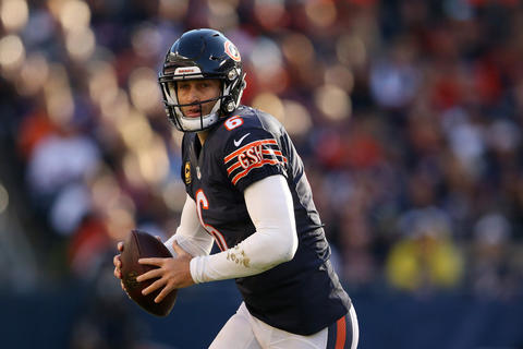 Jay Cutler looks to run the ball in for a touchdown during the second half against the Vikings.