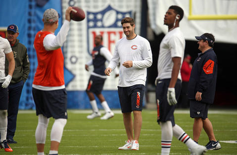 Bears quarterback Jay Cutler warms up with teammates at Qualcomm Stadium.