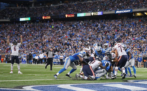 Jay Cutler celebrates as running back Matt Forte scores a touchdown in the fourth quarter against the Detroit Lions.