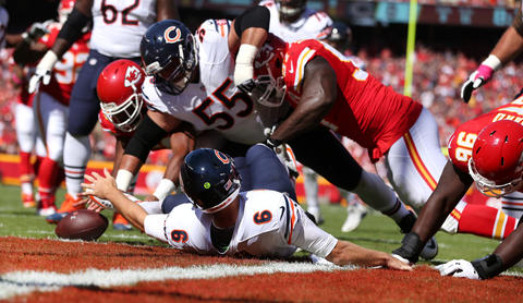 Jay Cutler fumbles the ball as the Chiefs recover it for a touchdown in the first quarter at Arrowhead Stadium.