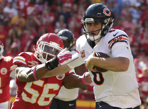 Jay Cutler breaks a tackle by Chiefs linebacker Derrick Johnson during the second half.