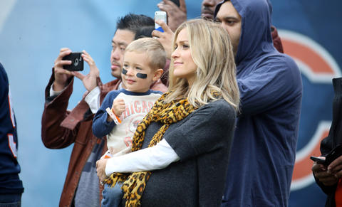 Jay Cutler's wife Kristin Cavallari watches warmups.