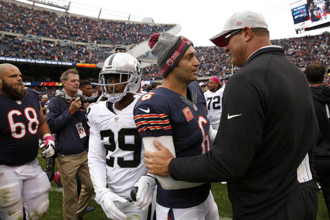 Jay Cutler chats with former Bears offensive coordinator Mike Tice and Oakland Raiders offensive line coach following a 22-10 Bears win.