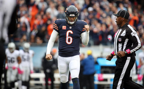 Jay Cutler celebrates his touchdown pass in the first quarter against the Raiders.