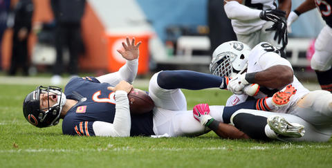 Jay Cutler is sacked by Raiders defensive end Justin Tuck.