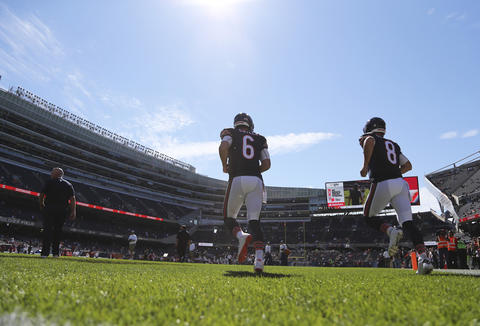 Quarterbacks Jay Cutler and Jimmy Clausen take the field for the Week 2 game against the Cardinals at Soldier Field.