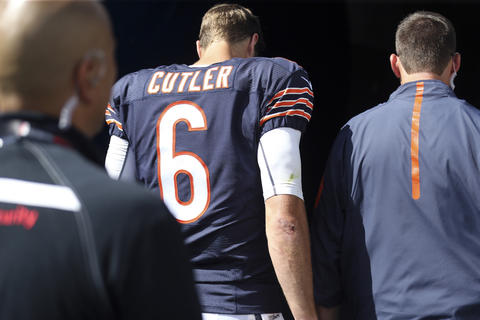 Jay Cutler walks to the locker room with an injury after he threw an interception to the Cardinals late in the first half.