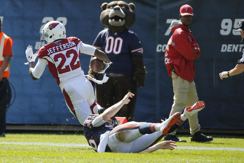 The Cardinals' Tony Jefferson runs back an interception for a touchdown as Jay Cutler tries to make the tackle in the second quarter. Cutler was injured on the play.