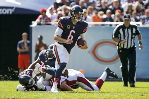 Jay Cutler runs with the ball against the Cardinals in the second quarter at Soldier Field.