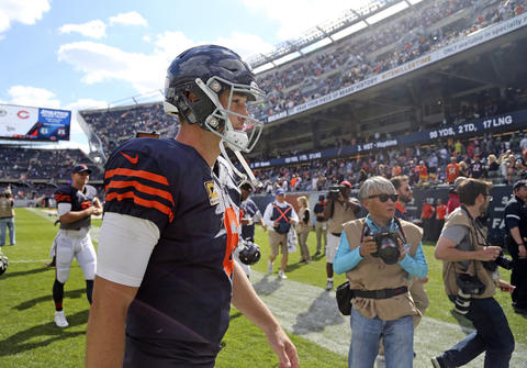 Jay Cutler walks off the field after his team's loss to the Green Bay Packers.