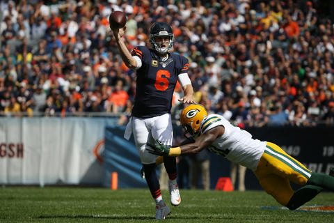 Jay Cutler tries to get off a pass before being tackled by Green Bay Packers linebacker Jay Elliott during the first quarter oftheir game.