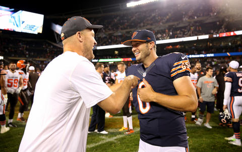 Bears quarterback Jay Cutler and Browns quarterback Josh McCown greet one another after a preseason game at Soldier Field.