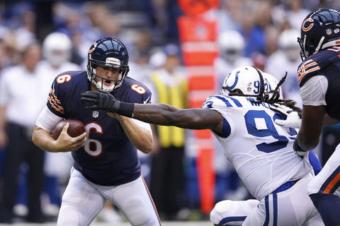 Jay Cutler gets pressure from the Colts' Erik Walden in the first half of a preseason game at Lucas Oil Stadium.