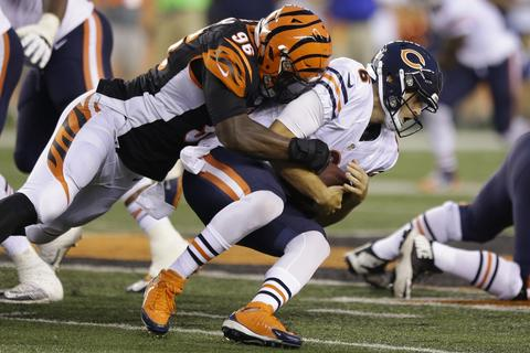 Jay Cutler is sacked by Bengals defensive end Carlos Dunlap during the first half.