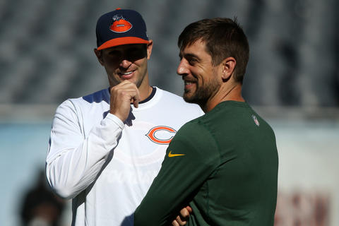 Packers quarterback Aaron Rodgers chats with Jay Cutler prior to their game.