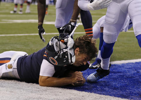 Bears quarterback Jay Cutler loses his helmet as he dives into the end zone during the first half of a preseason game against the Colts. The play was negated by a penalty.