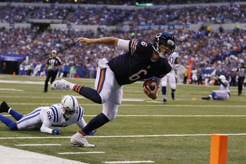 Bears quarterback Jay Cutler is tripped up by Colts cornerback Darius Butler in the first half.