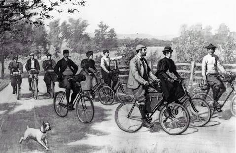 American country lanes in the 1890s teemed with nature-loving cyclists like these, including such confident types as the pipe smoker with his hands in his pockets.